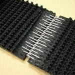 Closeup of clipper lacing holding two pieces of conveyor belting together