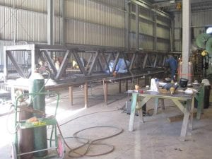 Custom built conveyor structure in industrial warehouse