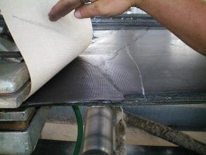 closeup of clean conveyor belt repair