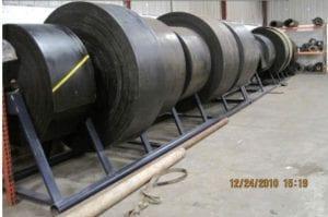 Rolls of conveyor belts in warehouse
