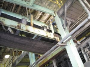Close up of rusted conveyor system exterior