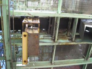 Side view of old rusted conveyor system