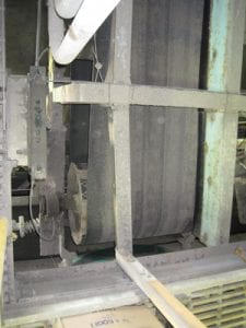 Closeup of old conveyor system pulley