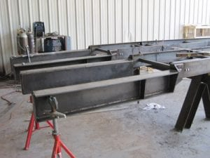 Steel chassis for conveyor system being welded in a factory