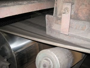 Closeup of newly installed pulley in conveyor system
