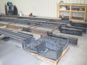Galvanized trough frames for new conveyor system being fabricated in a warehouse