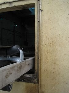 Exterior view of conveyor system components at wastewater treatment plant