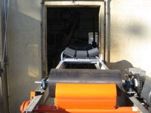 Inline idlers on conveyor system at wastewater treatment plant