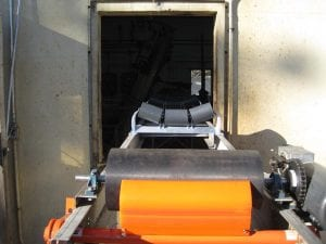 New Conveyor System going into factory wall