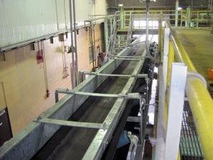Brand new conveyor system in factory, indoor overhead view