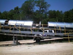 Crew performing maintenance on conveyor belt covers