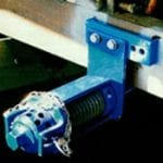Radial tensioner for conveyor belti system