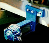 Radial tensioner for conveyor belti system