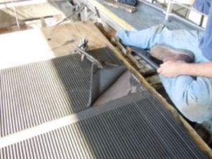 Worker repairing speedwalk components